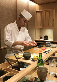 The chef at Sushi Iwa in Tokyo prepares a meal. Photo courtesy of Philip Courter.